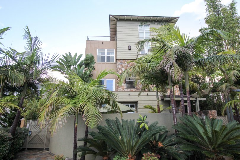 Three story residential building with palm trees at Bridgend Lanai in Coronado California