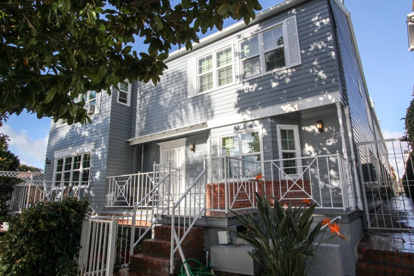 Two story residential units with white gate at Cape Coronado in Coronado California