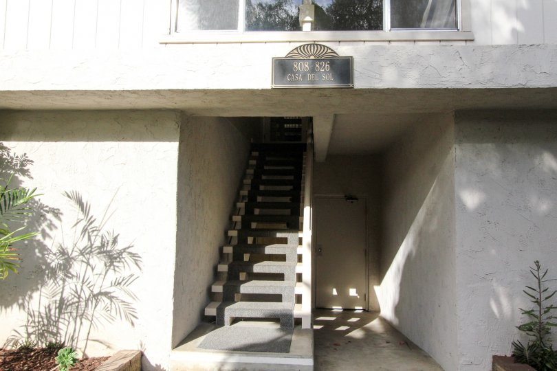 Gray stairway leading up to a residence at Casa Del Sol in Coronado CA