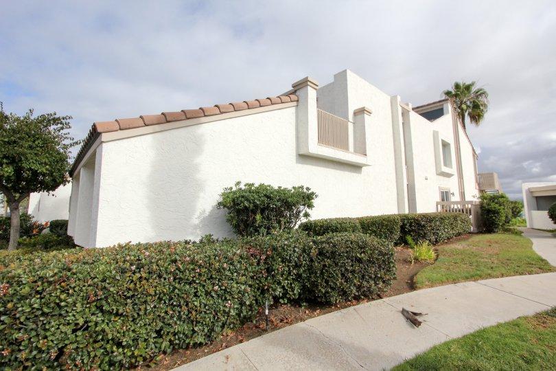 Two story white residential units at Coronado Cays in Coronado California