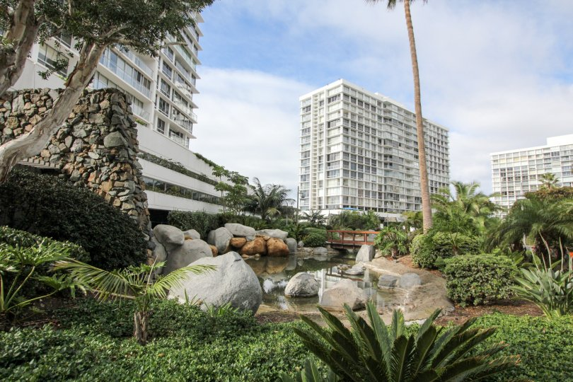 Rock stream flowing inside the Coronado Shores beside high rise apartments.