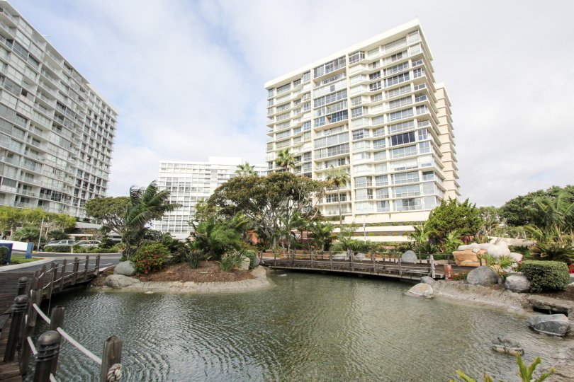 Apartment high rises surround a landscaped pond in Coronado Shores