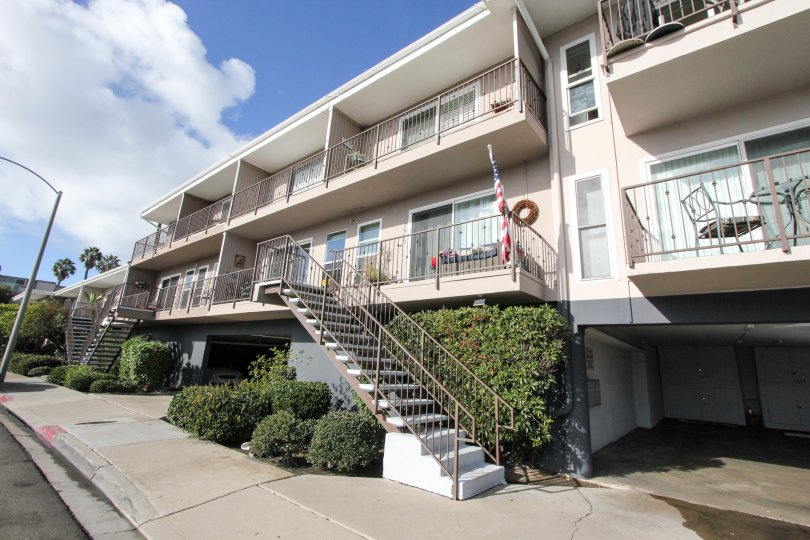 Three story housing with attached stairway at Glorietta Bay in Coronado California