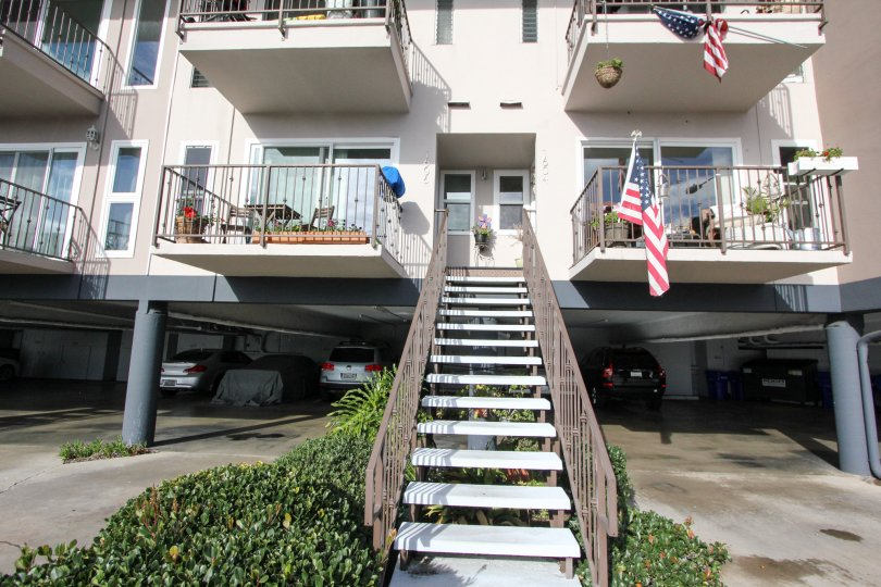 Two story residential building with parking at Glorietta Bay in Coronado California