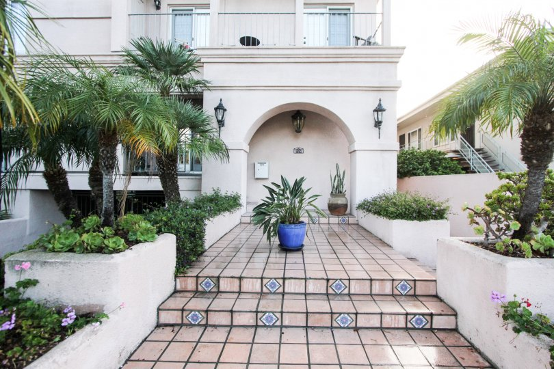 A tiled walkway leads to the entrance to a residence in Harborside Court