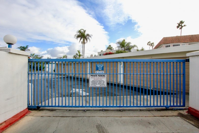 Gate to gated community in warm location with parking lot