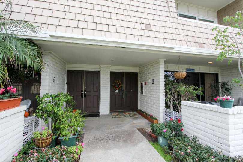 Two story residential units with plants at Montego Village in Coronado California