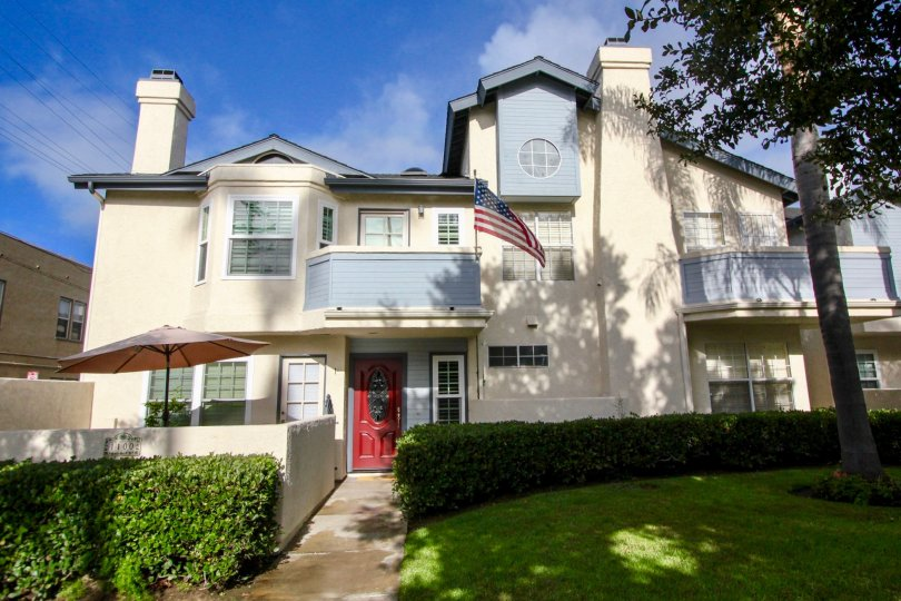 A large home with a red door on a sunny day in Oxford park Coronado California