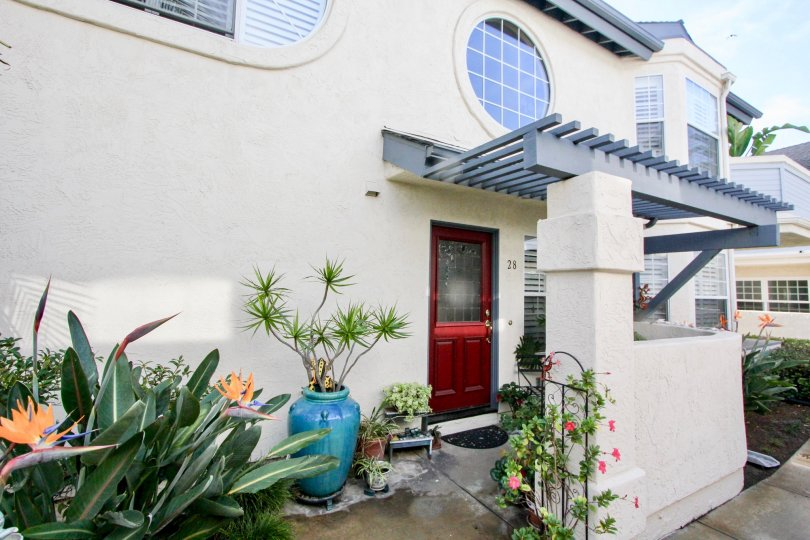 Two story housing with plants and awning at Oxford Park in Coronado California