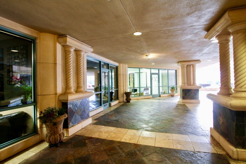 Marble walkway with fancy pillars and ceiling mounted lighting at Regatta Bay in Coronado CA