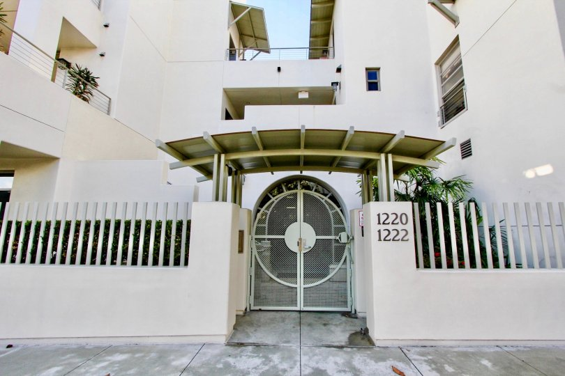 a beautiful white colored house with a good furnished entrance and door number,