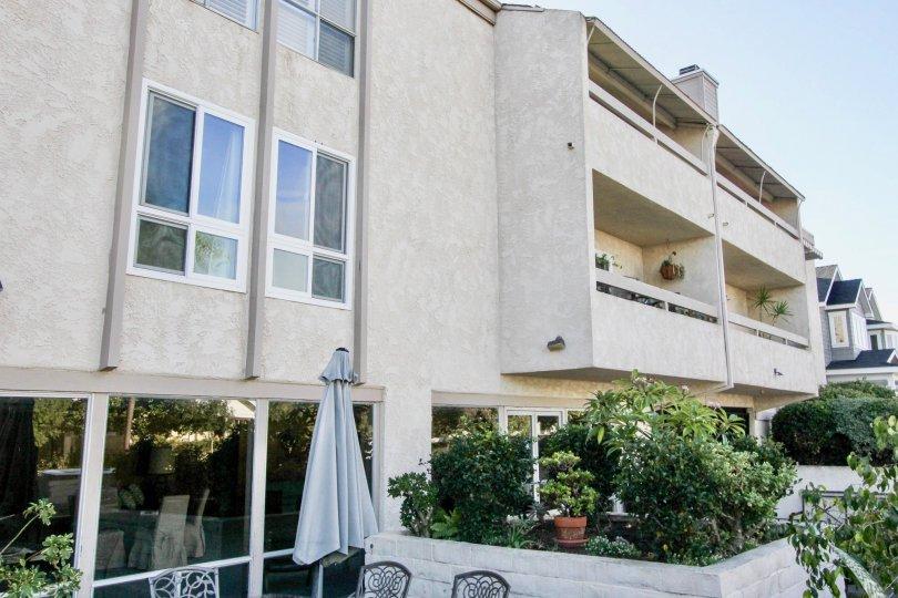 Three story building with trees at Villa Corona in Coronado California