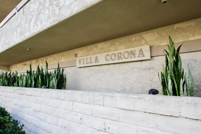 Community sign on wall at Villa Corona in Coronado California