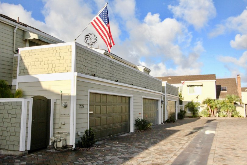 American flag hosted at the top of building at Village Townhomes at Coronado, California