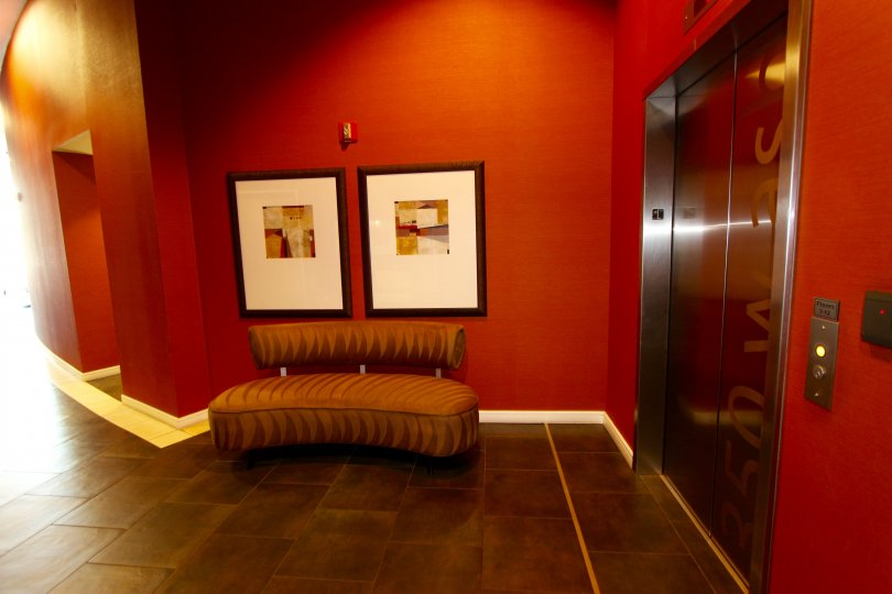 The red walled interior by the elevators at 350 West Ash