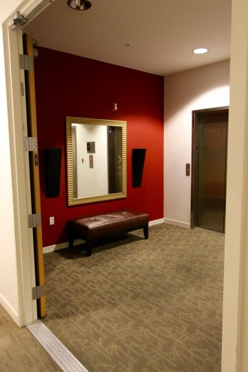 A beautiful red and wight color lift rest room in the 350 West Ash