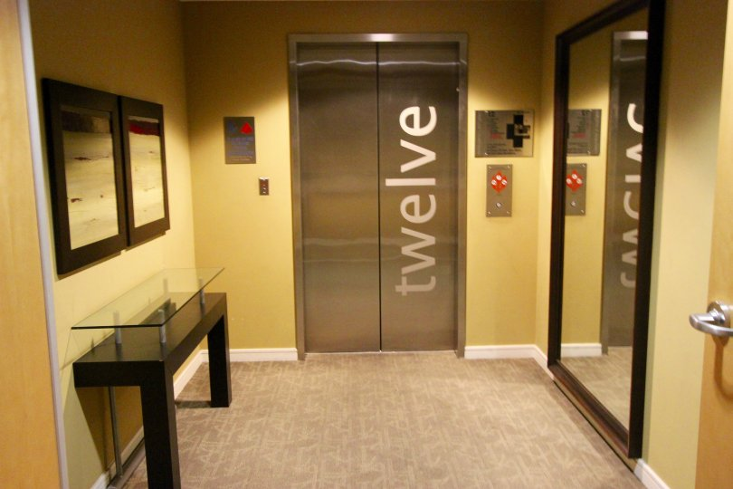 Two silver elevator doors inside 350 West Ash in Downtown San Diego