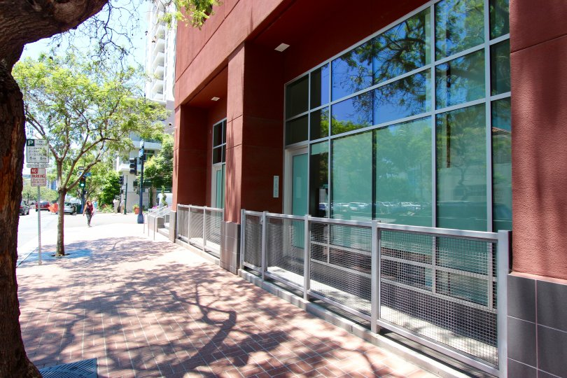 Sidewalk and Front view of 350 West Ash Condo Downtown San Diego California Red Block