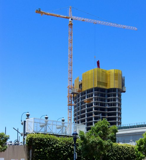A huge crane using to construct a high rise building in Downtown San Diego, California