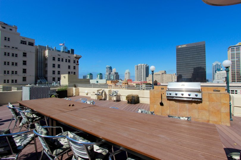 The tables on chairs on the roof of Samuel Fox Lofts