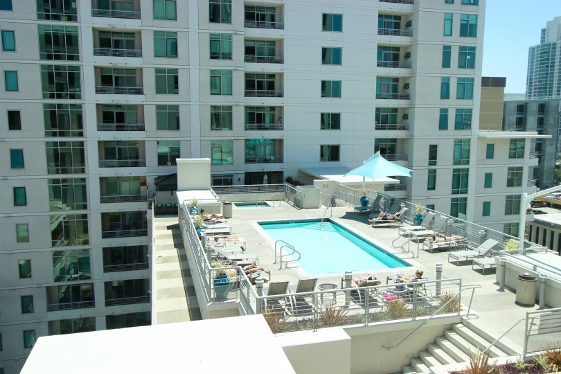 The Acqua Vista high rise condominium with a sun-drenched roof top pool in downtown San Diego, California