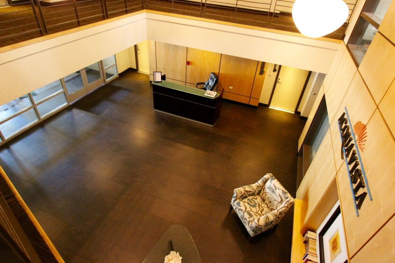 Lobby with hard wood floors and light furniture in Acqua Vista in Downtown San Diego CA