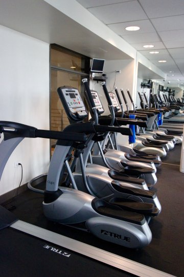 Workout room with fitness equipment at Acqua Vista.