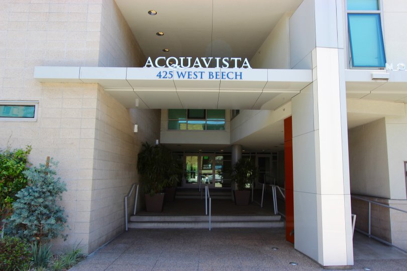 The exterior portico and glass door at the entry way of the Acqua Vista office building on West Beech