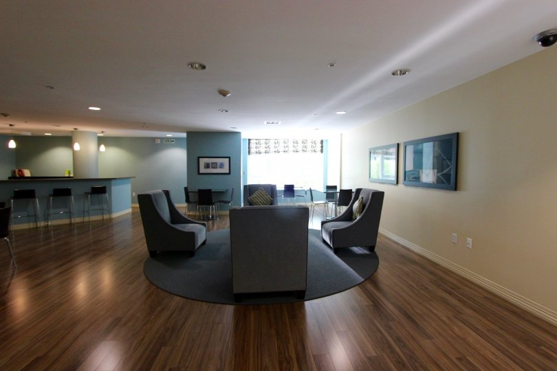 Sitting area with modern style chairs and hardwood floors in the Alicante community of Downtown San Diego, California