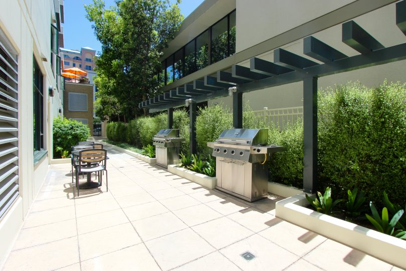 Grills and Tables in the Outdoor BBQ Area of the Alicante Condos in the Banker's Hill Neighborhood of Downtown San Diego, CA