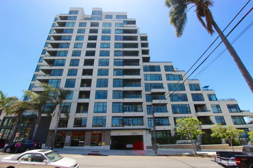 multi-residence high rise condo complex featuring modern architecture, large picture windows and private balconies in Alicante community of Downtown San Diego.
