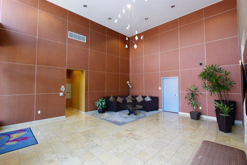 A sunny day in the area of Alicante, lobby, couch, lights, door, elevator