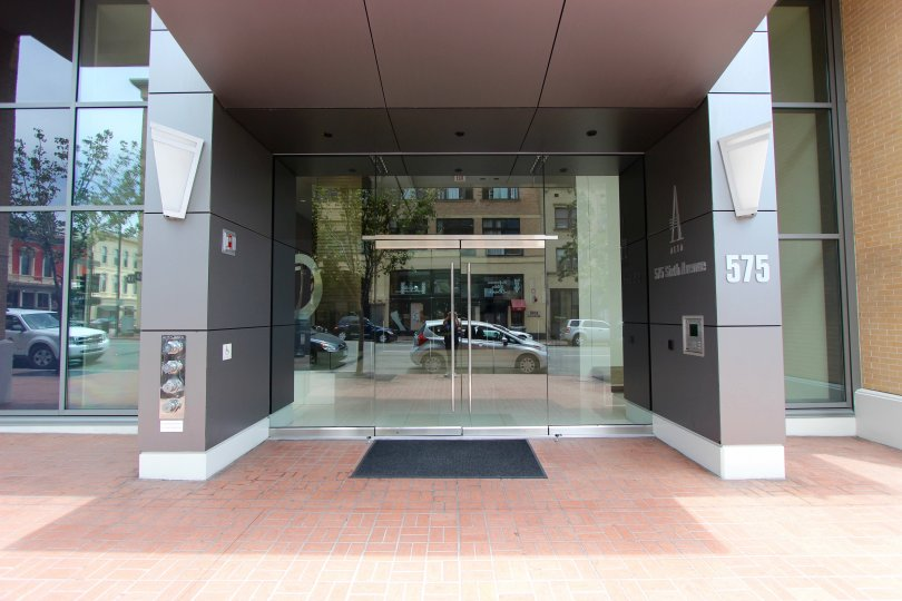 Modern yet inviting glass entryway in the Alta community of Downtown San Diego, California.
