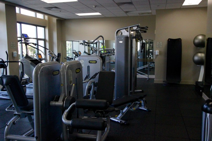 Weight machines and treadmills in Alta fitness center, San Diego, CA