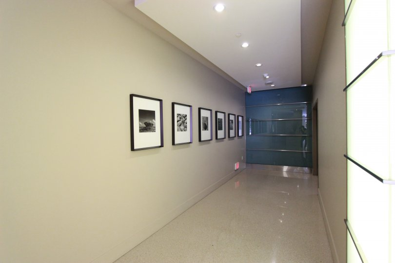 Photographs on display in a hallway in Downtown San Diego, California.
