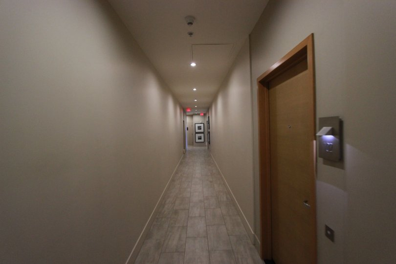 Narrow corridor in front of the entrance door with nice tiles in Aria.