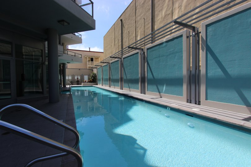 Icon, City: Downtown San Diego, A beautiful swimming pool with buildings on both the sides