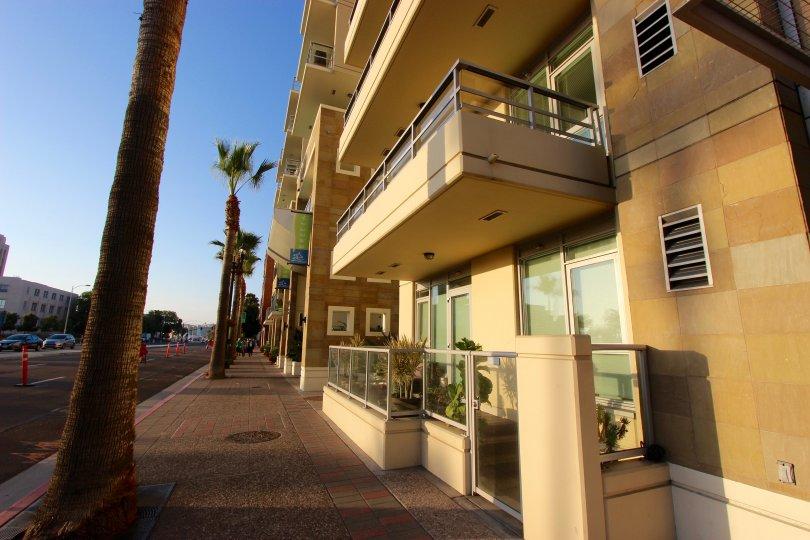 A second floor balcony overlooks the street at Breeza condos