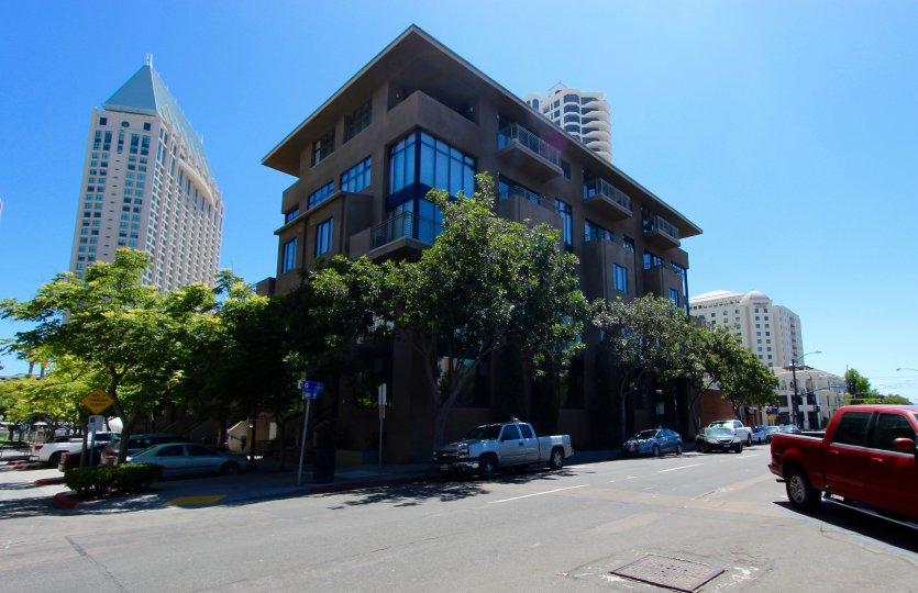 A corner view of a Brickyard building on a beautiful sunny day in Downtown San Diego, CA