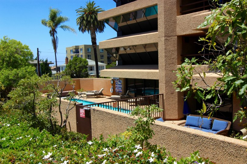 An exterior view of the private swimming pool and outdoor seating area atBrittany Town in downtown San Diego, CA