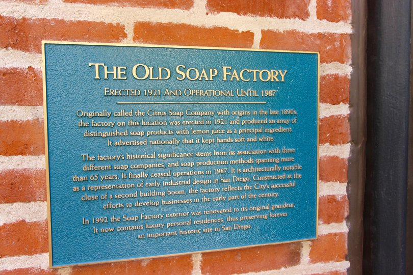 "The ""Old Soap Factory"" plate on a brick wall in Cityfront Terrace"