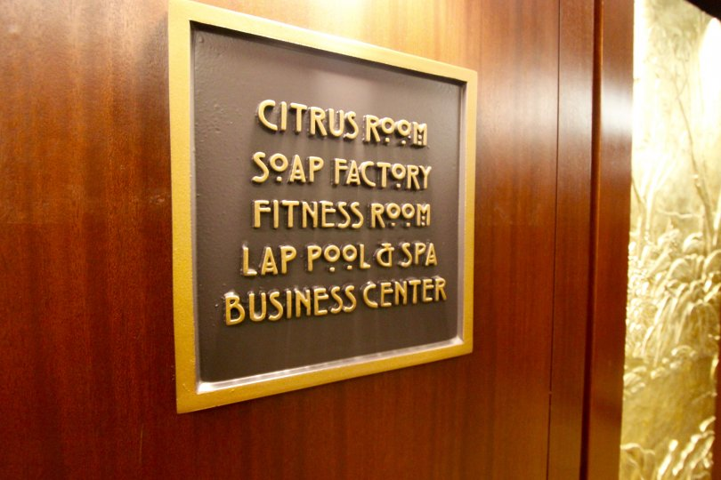 A sign for the Citrus Room, Soap Factory, Fitness room, Lap pool & spa and business center in City front terrace