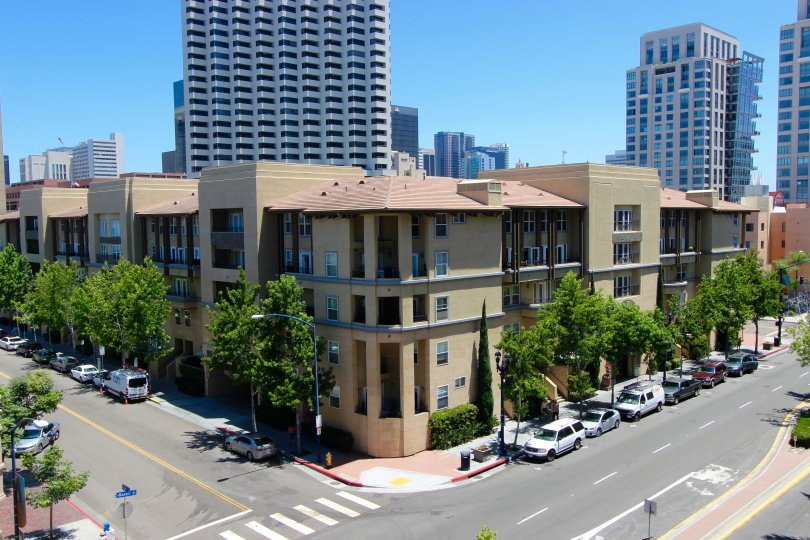 A sunny day in the citywalk community of Downtown San Diego California. An apartment building with high rises behind it