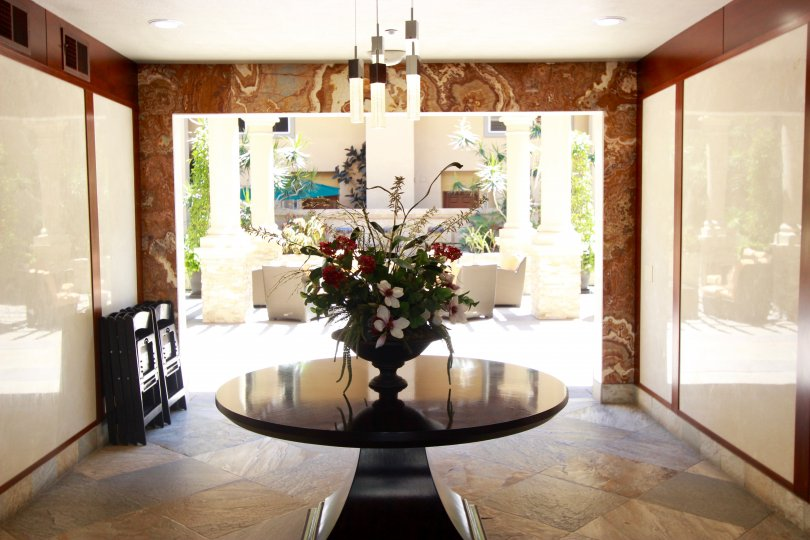 Sunny, marble foyer leading to private courtyard at Citywalk in Downtown San Diego, California