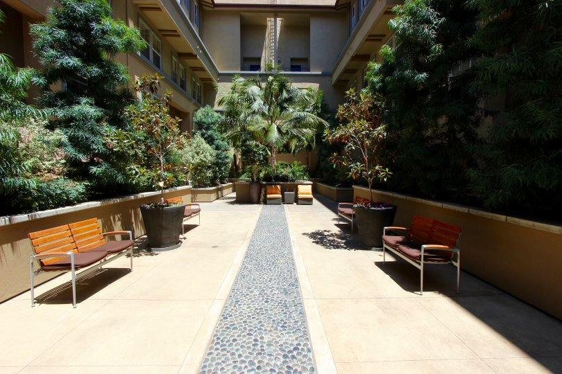 Private courtyard surrounded by greenery at Citywalk in Downtown San Diego, California