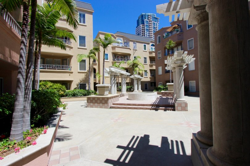 A sunny day in the area of Columbia Place, outside, stairs, palm trees, condos, sidewalk