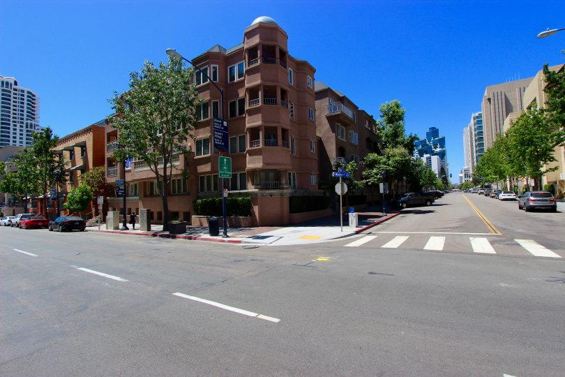 four story brown condo buildings at Columbia Place located in Downtown San Diego CA
