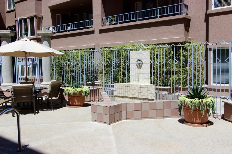 A fountain sits in a brick holder at Columbia Place condos.