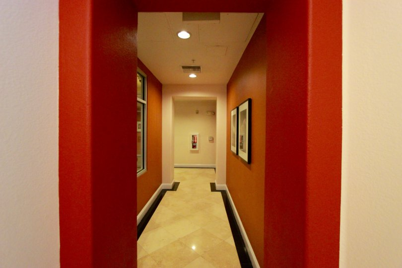 A bright red hallway with wall art at Crown Bay in downtown San Diego, CA.