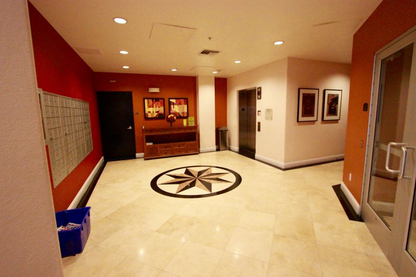 Tiled floor with center design and matching coloring to the walls in Crown Bay.